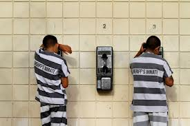 prison inmates on phones